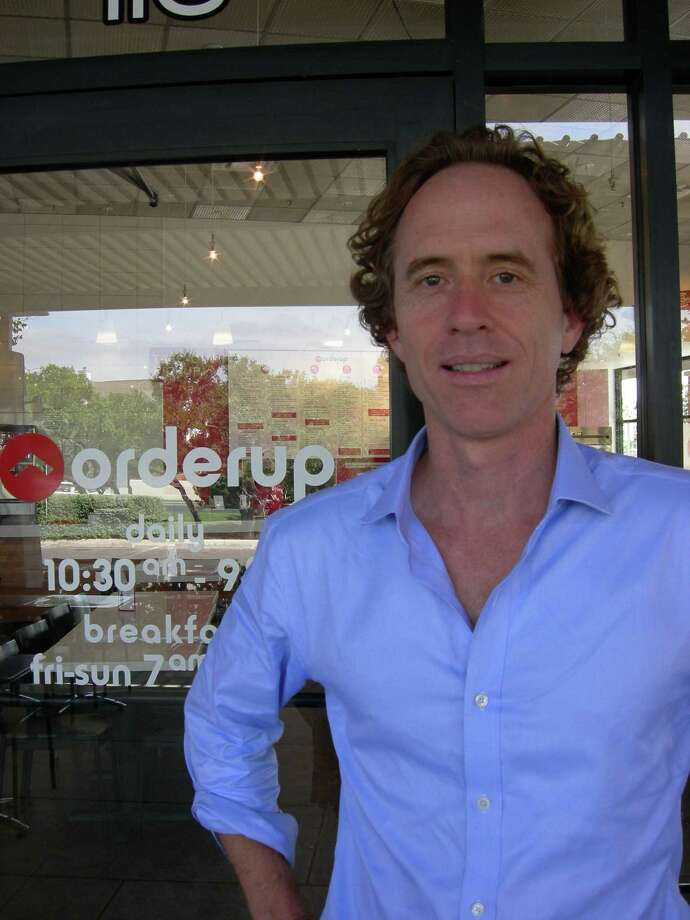 Orderup owner David Galbreath switched the restaurants' focus to burgers, but still offers tacos. Photo: Stefanie Arias / San Antonio Express-News