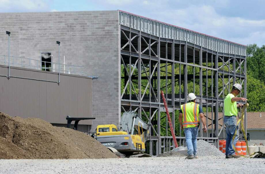 Construction is underway for an expansion at Regeneron Pharmaceuticals Tuesday, Aug. 6, 2013, in East Greenbush, N.Y. Sales of Regeneron' s Eylea eye drug have been highly successful. (Lori Van Buren / Times Union) Photo: Lori Van Buren / 00023436A