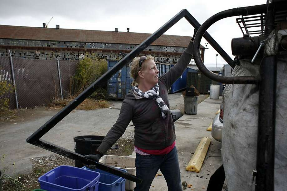 Hatti Flanagan sorts metals to sell at Sims. She said thieves won't be daunted by the permit and that she's considering suing the city. Photo: Lacy Atkins, The Chronicle