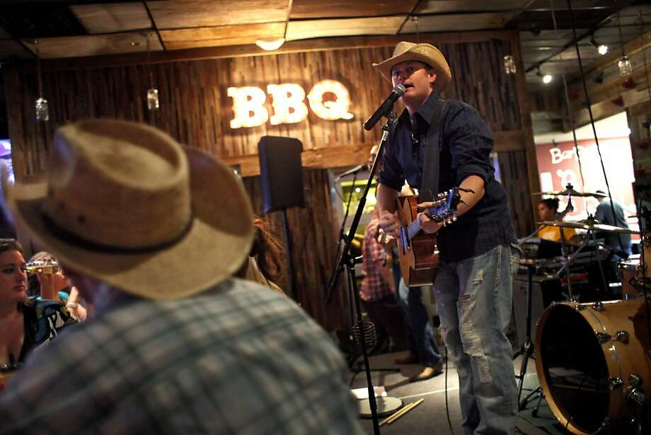 The Michael Beck Band plays at Sauced BBQ & Spirits, one of the region's many venues for live music. Photo: Preston Gannaway, Special To The Chronicle