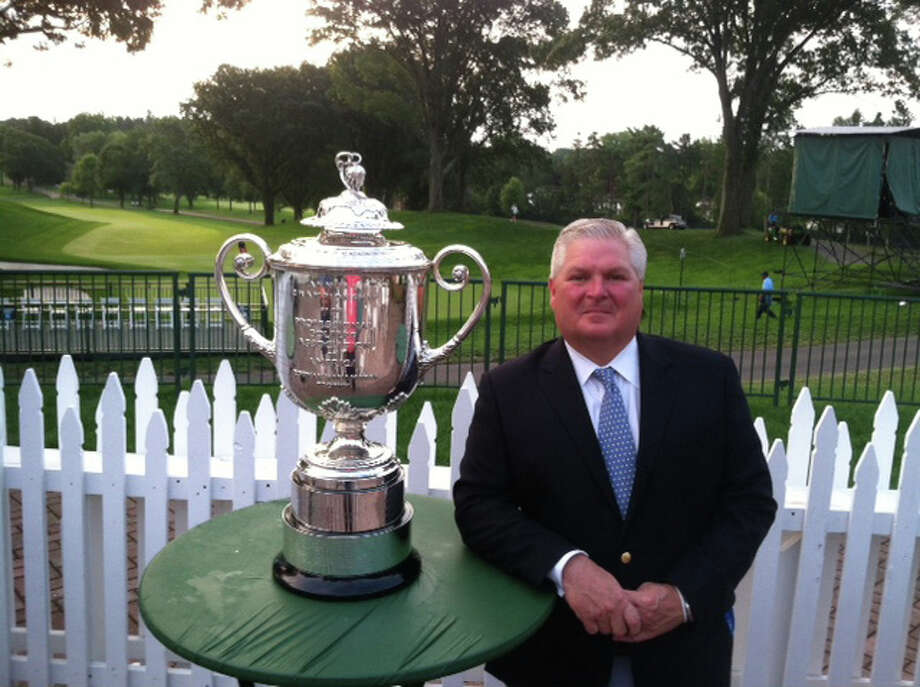 Oak Hill Country Club general manager Dan Farrell stands with the Wanamaker trophy, given to the winner of the PGA Championship. Farrell, who was the general manager at Greenwich's Innis Arden Golf Club from 2006-2012, has had a busy year getting the Pittsford, N.Y. club read to host the final major of the season this weekend. Photo: Contributed Photo