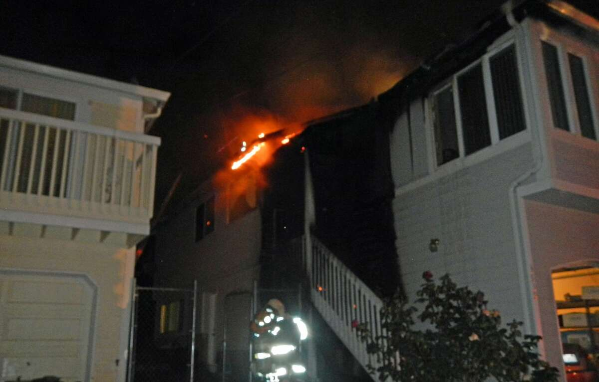 Seattle firefighters respond to an apparent arson on South Cloverdale Street in Beacon Hill.