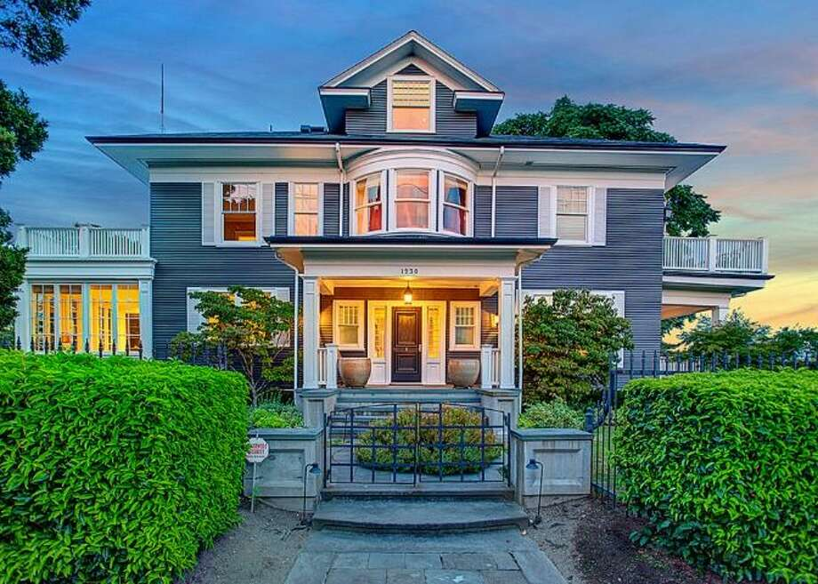 Got $4 million and a love of updated classic homes in Queen Anne? If so, then 1230 Warren Ave. N. might be for you. The 7,710-square-foot mansion, built in 1910, but completely overhauled, has seven bedrooms, 5.5 bathrooms, dark-stained floors and beams, a family room, a rec room, two balconies, and views of downtown, Elliott Bay and Mount Rainier on an 8,856-square-foot lot. It's listed for $3,999,950. Photo: Courtesy Jeffrey Valcik, Windermere Real Estate
