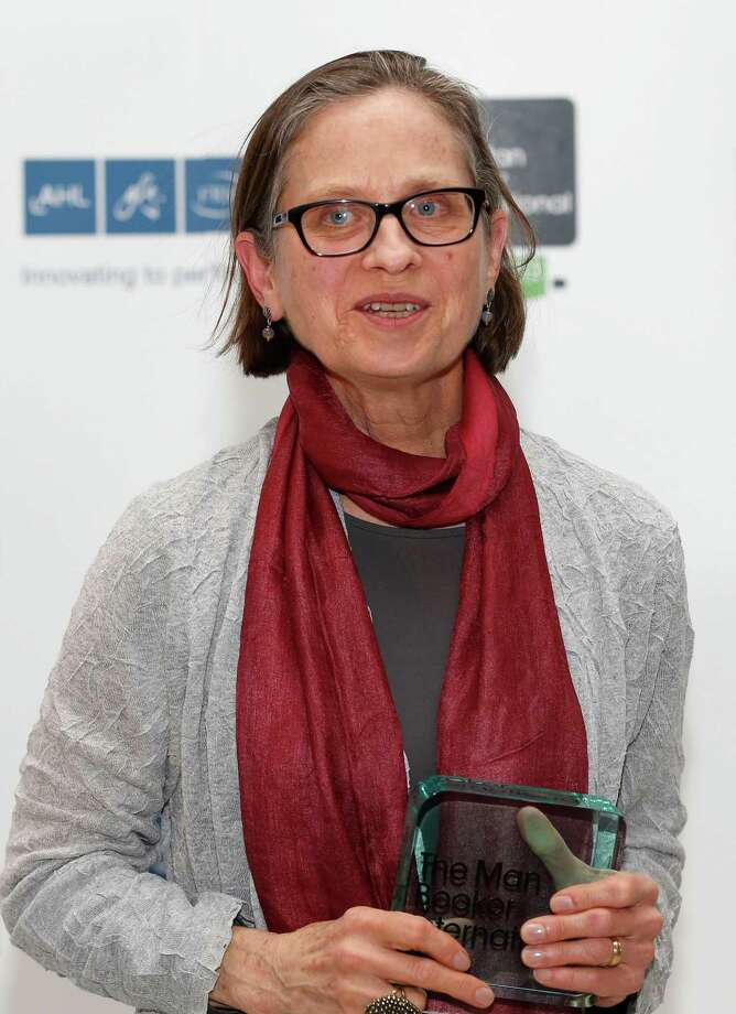 Lydia Davis of U.S. poses with the trophy after winning the Man Booker International Prize at an award ceremony in London, Wednesday, May 22, 2013. The Man Booker International Prize is awarded every two years to a living author who has published fiction either originally in English or whose work is available in translation in the English language. (AP Photo/Sang Tan) Photo: Sang Tan / AP