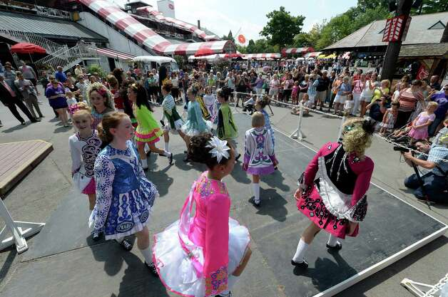 Members of Boland School of Irish Dance perform Thursday afternoon, Aug 8, 2013, during International Day  at Saratoga Race Course in Saratoga Springs, N.Y. (Skip Dickstein/Times Union) Photo: SKIP DICKSTEIN