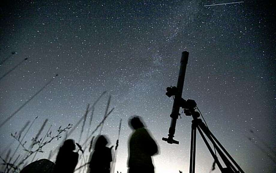 What about clouds? Don't they going to get in the way?Well, yes. The National Weather Service forecasts partly cloudy skies overnight. But that can always change. (Photo: Perseids in Bulgaria, 2009). Photo: Petar Petrov, AP