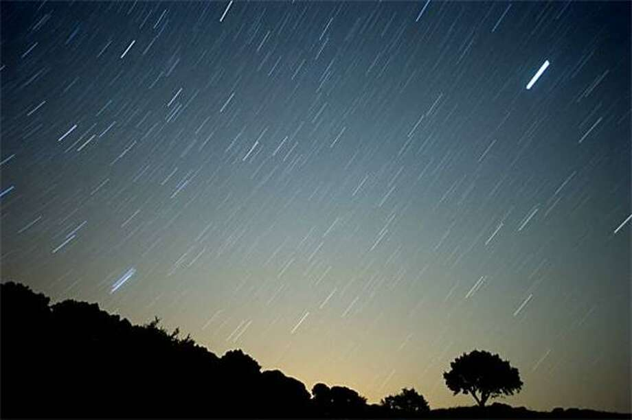 Why is Perseid more beloved than other meteor showers, like Leonid and Geminid?Perseid produces a consistently high number of meteors, between 50 to 100 streaks an hour during its peak. It has more  fireballs than other showers. And it happens in August, a nice time to be outside, versus dreary November, for example, when Leonid happens. (Photo: Perseid meteor streaks in Spain, 2010). Photo: Jorge Guerrero, AFP/Getty Images / AFP / Getty Images