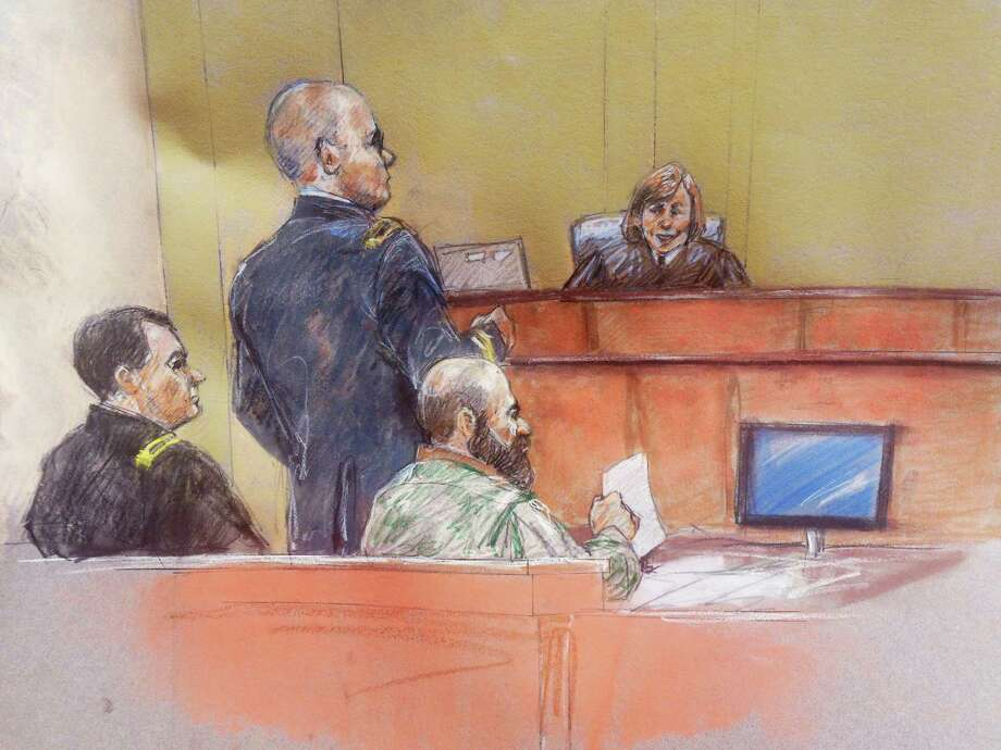 In this courtroom sketch, Maj. Nidal Hasan, second from right, sits with his standby defense attorneys Maj. Joseph Marcee, left, and Lt. Col. Kris Poppe, second from left, as presiding judge Col. Tara Osborn looks on, during Hasan's trial Thursday, Aug. 8, 2013, in Fort Hood, Texas. Hasan was allowed to continue representing himself on Thursday after the judge barred his standby attorneys from taking over, despite their claims that the Army psychiatrist was trying to secure his own death sentence. (AP Photo/Brigitte Woosley) ORG XMIT: TXKJ104 Photo: Brigitte Woosley / FR170958 AP
