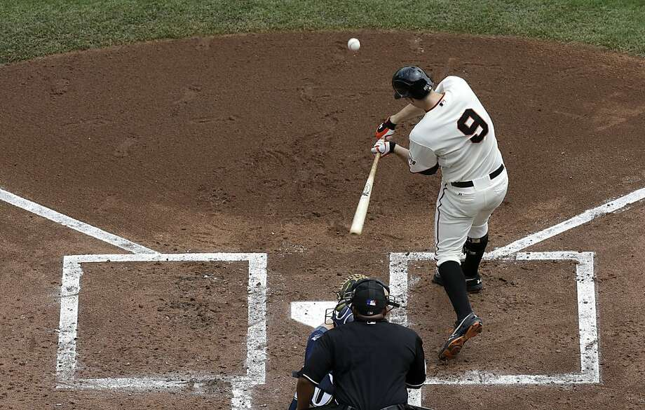 San Francisco Giants' Brandon Belt (9) hits a three-run home run off of Milwaukee Brewers pitcher Donovan Hand during the first inning of a baseball game in San Francisco, Thursday, Aug. 8, 2013. (AP Photo/Jeff Chiu) Photo: Jeff Chiu, Associated Press