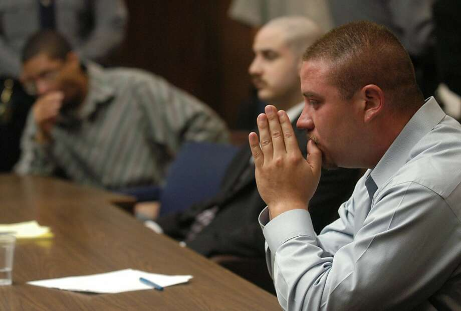 Jason Cazares, right, Jose Merel, left, and Michael Magidson, center, listen to verdicts in a Hayward, Calif., courtroom, Monday, Sept. 12, 2005, for the killing of Gwen Araujo. Merel and Magidson were found guilty of killing the transgender teen. They were both cleared of hate crime charges. The jury deadlocked in the case of Cazares, marking the second time a mistrial was declared. (AP Photo/Bea Ahbeck, pool)  Ran on: 09-13-2005 Jose Merel (left), Michael Magidson and Jason Cazares listen to the verdicts in a Hayward courtroom.  Ran on: 09-13-2005 Jose Merel (left), Michael Magidson and Jason Cazares listen to the verdicts in a Hayward courtroom.  Ran on: 09-13-2005 Jose Merel (left), Michael Magidson and Jason Cazares listen to the verdicts in a Hayward courtroom. Photo: Bea Ahbeck, AP