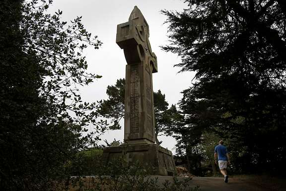 One can approach the Prayerbook Cross from a path off John F. Kennedy Drive Thursday August 8, 2013. The 57 foot high Celtic cross called Prayerbook Cross is one of the few surviving relics of the Midwinter Exposition of 1894.  It stands next to the top of Rainbow Falls in San Francisco's Golden Gate Park.