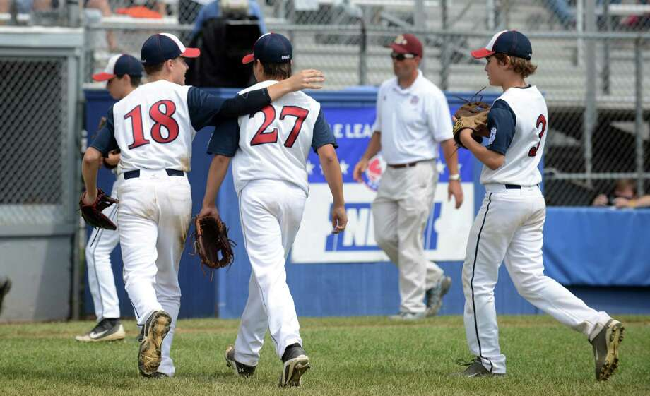 Westport pitchers Harry Azadian, left, and Chad Knight run off the field after their win over Sacro/Maremont, of Maine, in the Little League Baseball Eastern Regional Tournament game at Breen Field in Bristol, Conn. Thursday, August 8, 2013. Photo: Autumn Driscoll / Connecticut Post