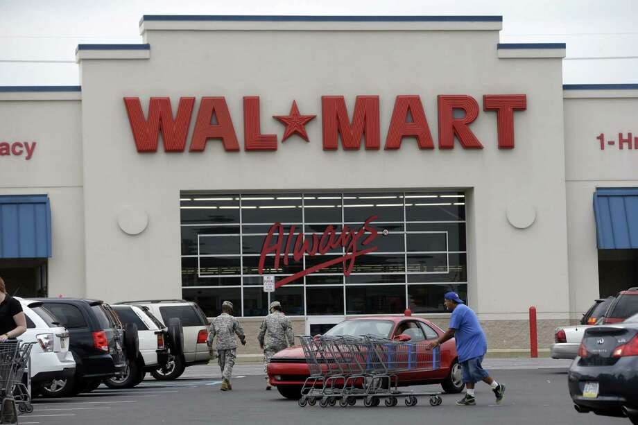 Walmart is ditching slow-selling products to make way for beer, even selling the alcoholic beverage in garden centers. New stores are designed to put the suds front and center. Photo: Matt Rourke / Associated Press