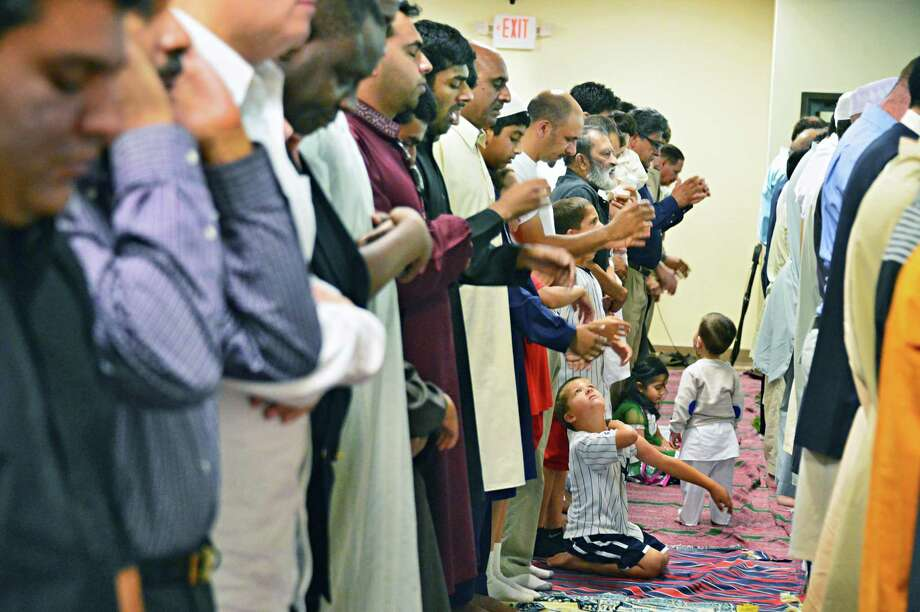Congregational prayers are made Thursday morning, Aug. 8, 2013, during the celebration of Eidul Fitr at the Muslim Community Center in Colonie, NY. Eidul Fitr celebrates the completion of Ramadan, the month where dawn to sunset fasting is observed by Muslims.   (John Carl D'Annibale / Times Union) Photo: John Carl D'Annibale / 00023433A
