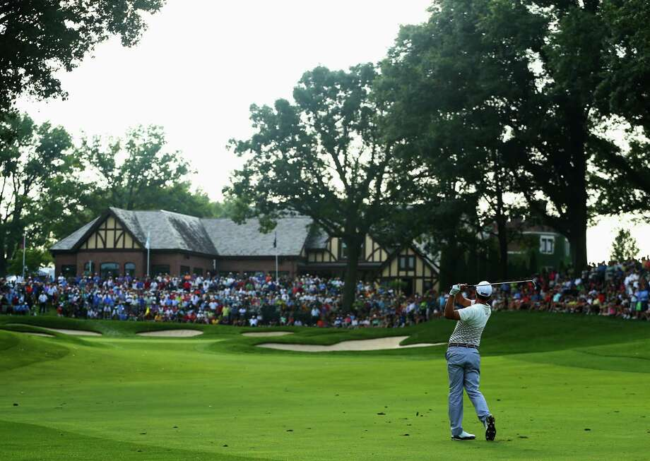 ROCHESTER, NY - AUGUST 08:  Adam Scott of Australia hits a shot on the 13th hole during the first round of the 95th PGA Championship on August 8, 2013 in Rochester, New York. Photo: Streeter Lecka, Getty Images / 2013 Getty Images