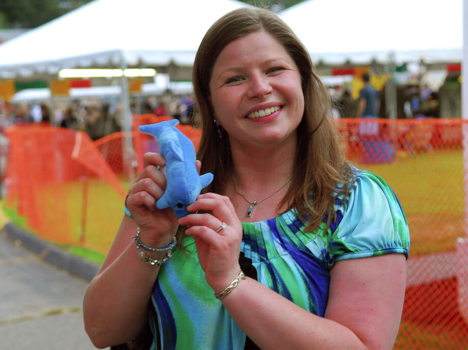 Candice Cardinali, of Milford, shows off the dolphin she won during Holy Rosary Parish's Festa 2013, which is the parish's 46th Annual Italian Festival in Ansonia, Conn. on Thursday August 8, 2013. The annual festival opens on Thursday Aug 8 and runs through Saturday August 10 from 5-10 p.m. Photo: Christian Abraham / Connecticut Post