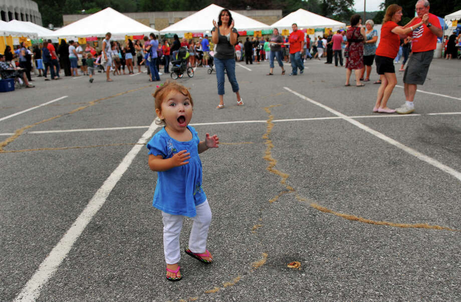 Gabriella Rich, 2, of Ansonia, dances as the band Illiguri plays Italian music, during Holy Rosary Parish's Festa 2013, which is the parish's 46th Annual Italian Festival in Ansonia, Conn. on Thursday August 8, 2013. The annual festival opens on Thursday Aug 8 and runs through Saturday August 10 from 5-10 p.m. Photo: Christian Abraham / Connecticut Post