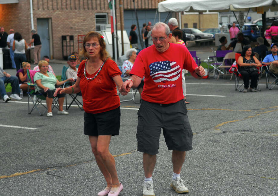 Josephine and Jim Serenson, of Thomaston, dance as the band Illiguri plays Italian music, during Holy Rosary Parish's Festa 2013, which is the parish's 46th Annual Italian Festival in Ansonia, Conn. on Thursday August 8, 2013. The annual festival opens on Thursday Aug 8 and runs through Saturday August 10 from 5-10 p.m. Photo: Christian Abraham / Connecticut Post