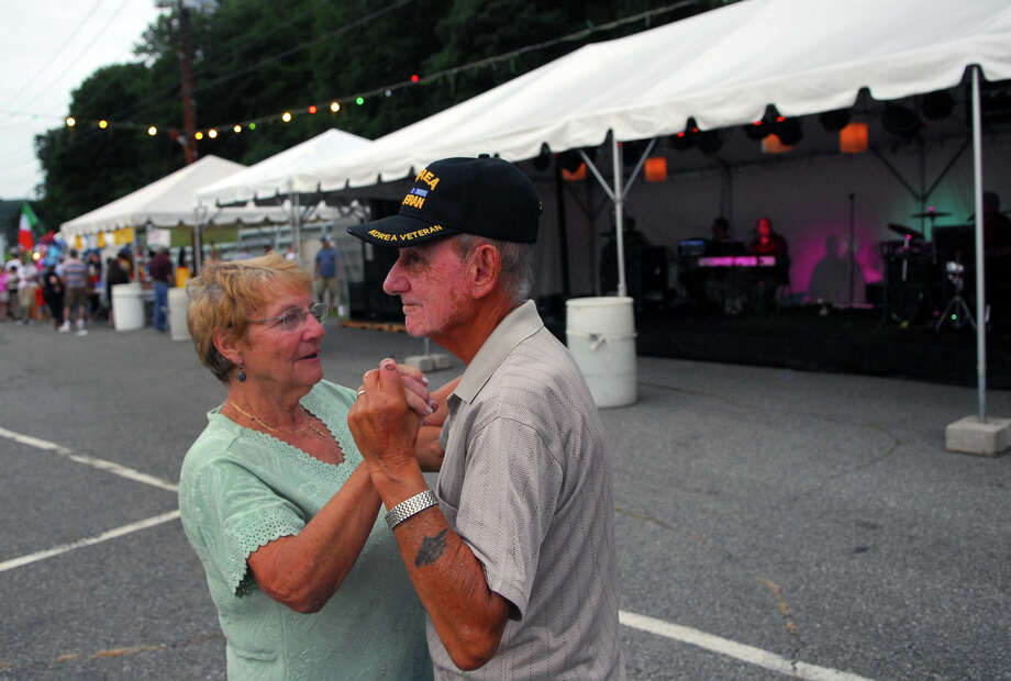 Simone and Maurice LePage, of Derby, dance as the band Illiguri plays Italian music, during Holy Rosary Parish's Festa 2013, which is the parish's 46th Annual Italian Festival in Ansonia, Conn. on Thursday August 8, 2013. The annual festival opens on Thursday Aug 8 and runs through Saturday August 10 from 5-10 p.m. Photo: Christian Abraham / Connecticut Post