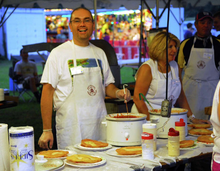 Volunteer Neil Torres gets pizzas ready during Holy Rosary Parish's Festa 2013, which is the parish's 46th Annual Italian Festival in Ansonia, Conn. on Thursday August 8, 2013. The annual festival opens on Thursday Aug 8 and runs through Saturday August 10 from 5-10 p.m. Photo: Christian Abraham / Connecticut Post