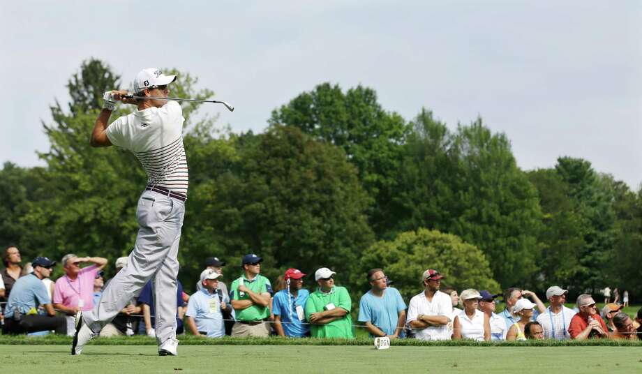 Adam Scott, of Australia, hits his tee shot  on the ninth hole during the first round of the PGA Championship golf tournament at Oak Hill Country Club, Thursday, Aug. 8, 2013, in Pittsford, N.Y. (AP Photo/Patrick Semansky)  ORG XMIT: NYPM246 Photo: Patrick Semansky / AP