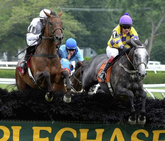 Take Her Tothe Top with jockey Xavier Aizpuru, left, jumps the final fence and goes on to the win Thursday afternoon, Aug 8, 2013, at  Saratoga Race Course in Saratoga Springs, N.Y.  There Grey Express, right,  with jockey Ross Geraghty took second. (Skip Dickstein/Times Union) Photo: SKIP DICKSTEIN