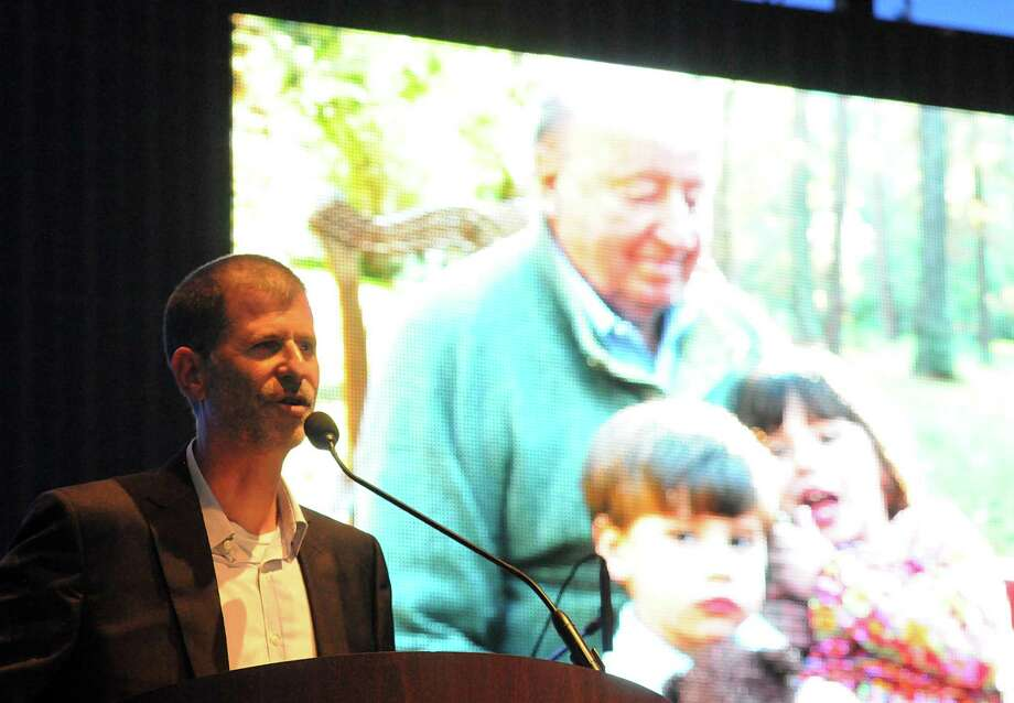 Todd Mitchell, one of George Mitchell's 10 children, speaks about his father during a slide show at the George Mitchell memorial tribute at the Cynthia Woods Mitchell Pavilion in The Woodlands. George Mitchell, who founded and started development in The Woodlands, died July 26. Photo: David Hopper, For The Chronicle / freelance
