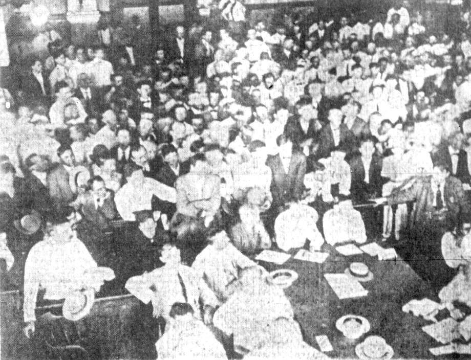 This photo, published August 23, 1913, San Antonio Express,of the packed double-height courtroom during the 1914 murder trial of Lee Johnson, was the only photo of the courtroom's interior that Fisher Heck Architects found to help them restore the room to its 1897 splendor. About 1,500 people were said to have attended the trial, but from the crowded photograph, architect Lewis Fisher was able to pick out a wall sconce, a railing, a wainscot and a pilatster, or column built into the wall. Photo: San Antonio Express-News File Photo / © 2013 San Antonio Express-News
