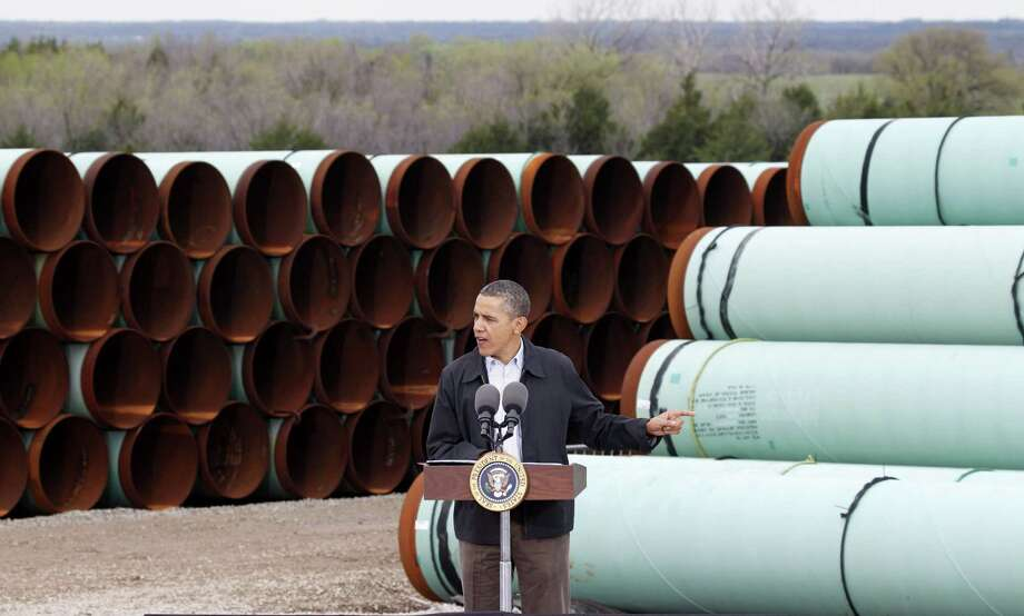 "FILE - In this Thursday, March 22, 2012 file photo, President Barack Obama speaks at the TransCanada Pipe Yard in Cushing, Okla. The president says that the proposed Keystone XL pipeline project from Canada to Texas should only be approved if it doesn't worsen carbon pollution. Obama says allowing the oil pipeline to be built requires a finding that doing so is in the nation's interest. He says that means determining that the pipeline does not contribute and ""significantly exacerbate"" emissions.  (AP Photo/LM Otero, File) Photo: LM Otero, STF / AP"