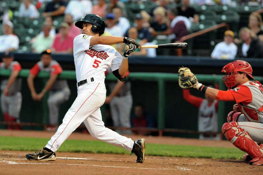ValleyCats Jack Mayfield, left, swings the bat their baseball game against Williamsport Crossscutters on Thursday, Aug. 8, 2013, at Bruno Stadium in Troy, N.Y. (Cindy Schultz / Times Union) Photo: Cindy Schultz / 10023388A