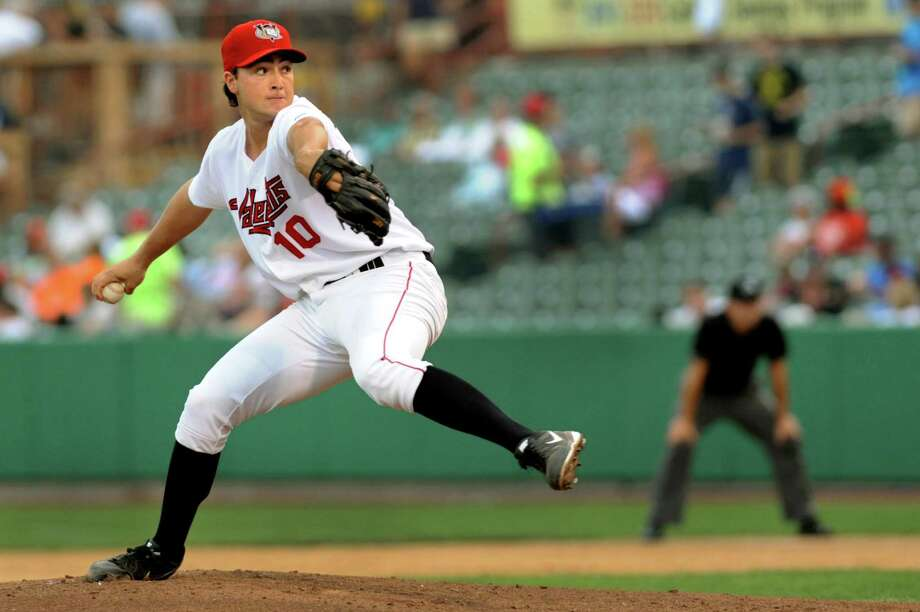 ValleyCats Andrew Thurman winds up the pitch during their baseball game against Williamsport Crossscutters on Thursday, Aug. 8, 2013, at Bruno Stadium in Troy, N.Y. (Cindy Schultz / Times Union) Photo: Cindy Schultz / 10023388A