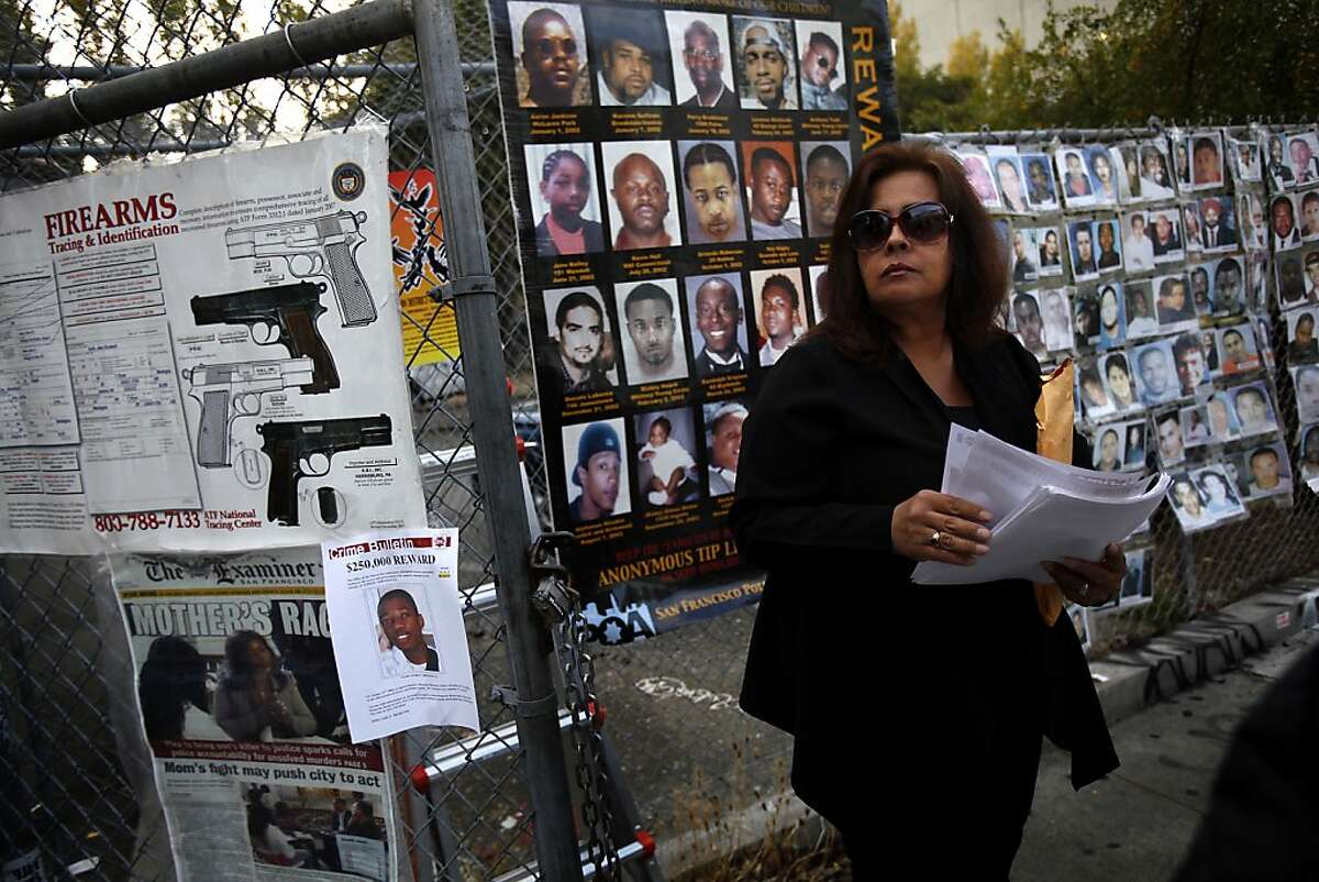Elsa Casillas hands out flyers for the unsolved murder of her son at a gun buy back program in the Mission, in San Francisco, Calif., Thursday, August 8, 2013. Guns were exchanged for $100, assault weapons for $200 -- no questions asked. The program was funded by San Francisco Supervisor David Campos' discretionary fund and GunbyGun.org which crowd sourced the money.