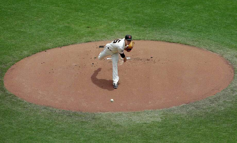 San Francisco Giants pitcher Tim Lincecum throws against the Milwaukee Brewers during the first inning of a baseball game in San Francisco, Thursday, Aug. 8, 2013. (AP Photo/Jeff Chiu) ORG XMIT: FXPB106 Photo: Jeff Chiu / AP