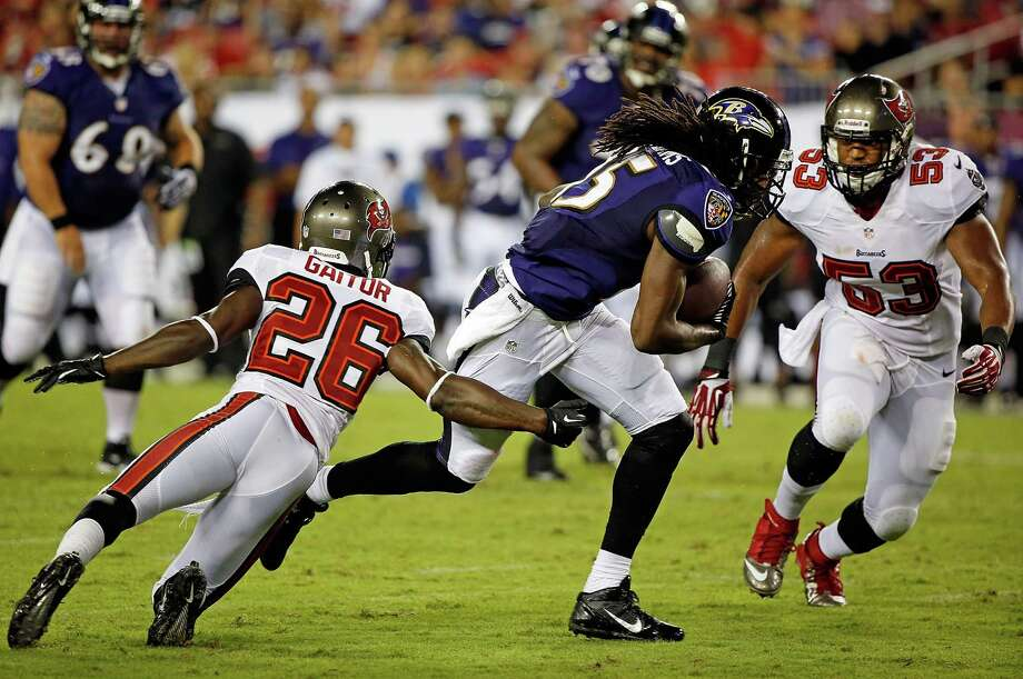 TAMPA, FL - AUGUST 08:  Receiver LaQuan Williams #15 of the Baltimore Ravens runs after a catch as defenders Anthony Gaitor #26 and Najee Goode #53 of the Tampa Bay Buccaneers pursue during a preseason game at Raymond James Stadium on August 8, 2013 in Tampa, Florida.  (Photo by J. Meric/Getty Images) ORG XMIT: 173403087 Photo: J. Meric / 2013 Getty Images