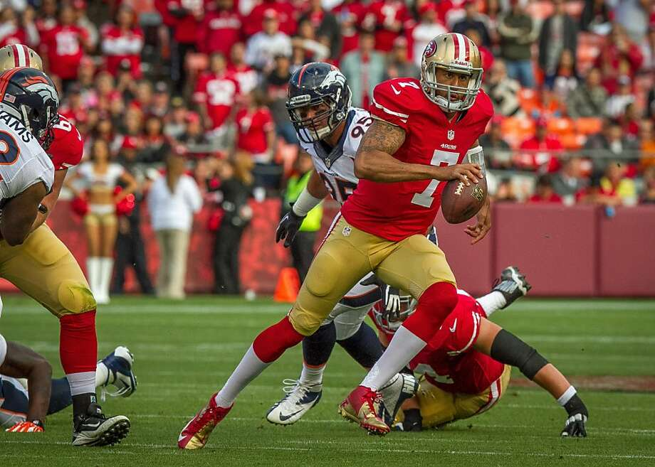 49ers quarterback Colin Kaepernick runs for a first down  against the Denver Broncos at Candlestick Park in San Francisco, Calif., is seen on Thursday, August 8th, 2013. Photo: John Storey, Special To The Chronicle