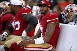 San Francisco 49ers quarterback Colin Kaepernick sits on the sidelines during Thursday night's preseason game against the Denver Broncos at Candlestick Park on August 8, 2013.