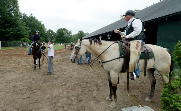 Trainer D. Wayne Lukas gives his exercise riders their instructions Thursday morning Aug. 8, 2013, at Saratoga Race Course in Saratoga Springs, N.Y.      (Skip Dickstein/Times Union) Photo: SKIP DICKSTEIN