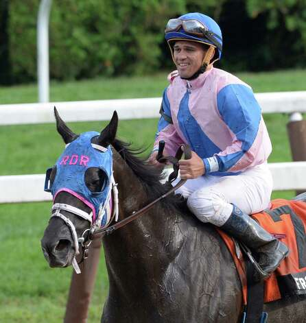 Frosty Bay with jockey Javier Castellano returns to the winner's circle after winning the 11th running of The New York Stallion Series Statue of Liberty Division at the Saratoga Race Course Aug 8, 2013,  in Saratoga Springs, N.Y.       (Skip Dickstein/Times Union) Photo: SKIP DICKSTEIN
