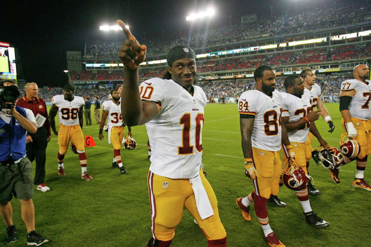 The only field time Robert Griffin III (10) got in the Redskins' preseason opener was for the coin toss and, of course, to exit after the 22-21 win over the Titans.