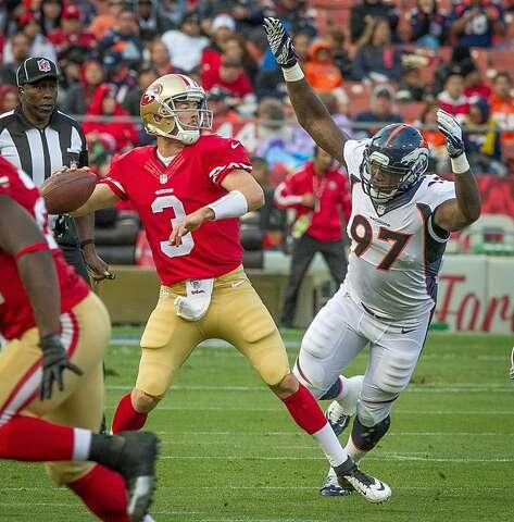 1244ddfd3 49ers quarterback Scott Tolzien is pressured by Denver s Malik Jackson at  Candlestick Park in San Francisco