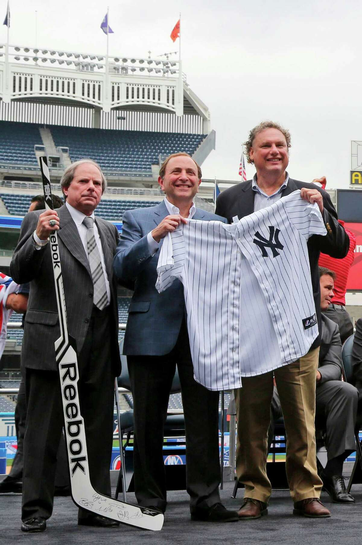 New York Yankees chief operating officer Lonn Trost (from left), NHL commissioner Gary Bettman and Yankees president Randy Levine stand in Yankee Stadium on the spot where the New York Rangers will play twice in January - two of six games the league will play outdoors as part of its 2013-14 season.