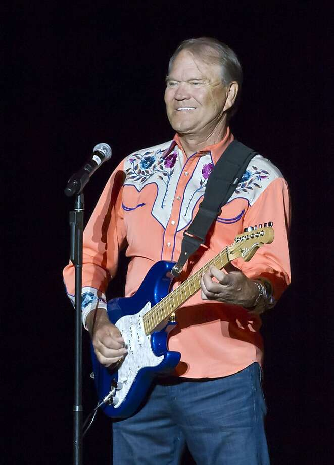 FILE - In this Sept. 6, 2012 file photo, singer Glen Campbell performs during his Goodbye Tour in Little Rock, Ark. Campbell finished off his Goodbye Tour on Friday night, Nov. 30, 2012, in Napa, Calif., but is considering scheduling more dates in 2013. The singer has Alzheimer's disease.  (AP Photo/Danny Johnston, File) Photo: Danny Johnston, Associated Press