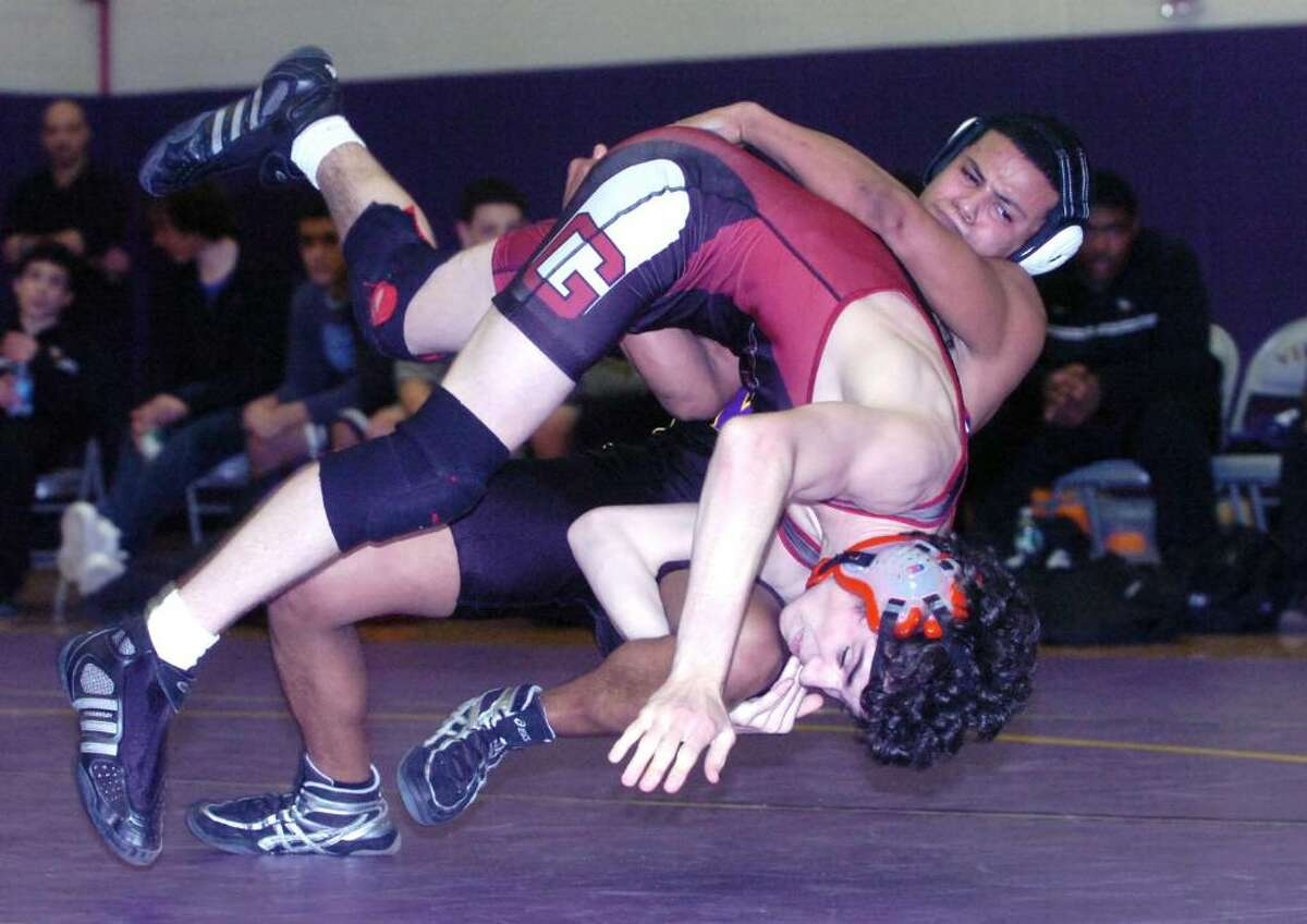 Westhill's Cris Chapparro takes on Greenwich's Victor Cerio in the 130 pound division as Westhill High hosts Greenwich in a wrestling match Wednesday, January 20, 2010. Cerio won the bout in overtime.