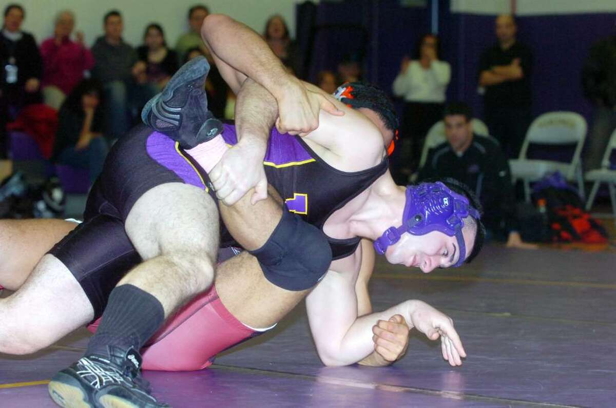 Westhill's Cosmo Ladanza wrestles Greenwich's Montel Williams to win the 189 pound division as Westhill High hosts Greenwich in a wrestling match Wednesday, January 20, 2010.