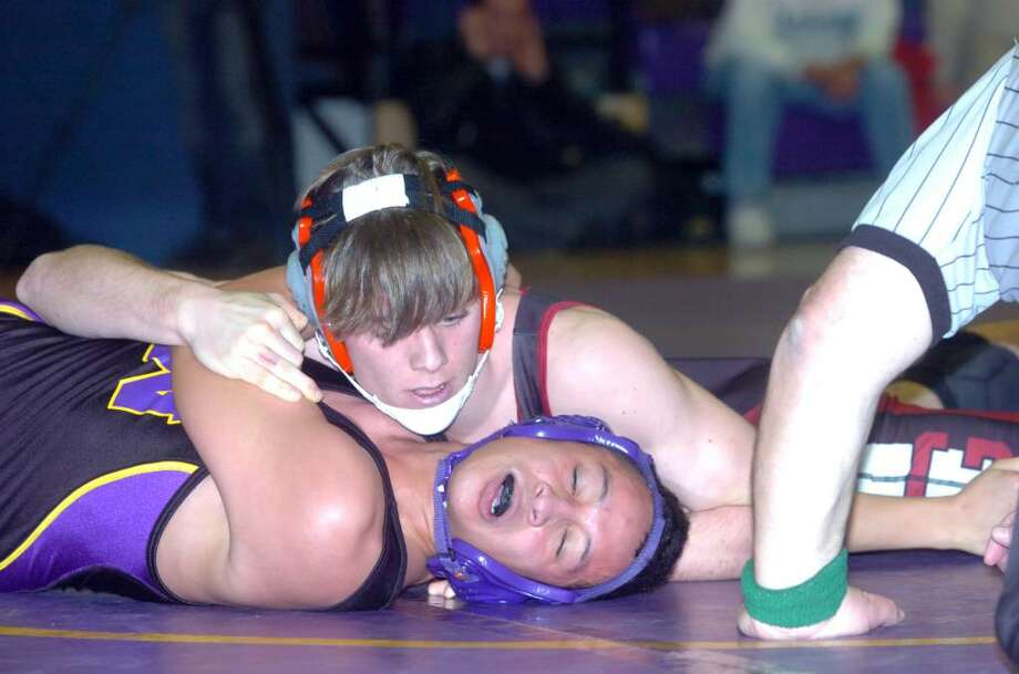 Greenwich's Jay Cummiskey finishes Westhill's Walter Martinez to win the 145 pound division as Westhill High hosts Greenwich in a wrestling match Wednesday, January 20, 2010. Photo: Keelin Daly / Greenwich Time