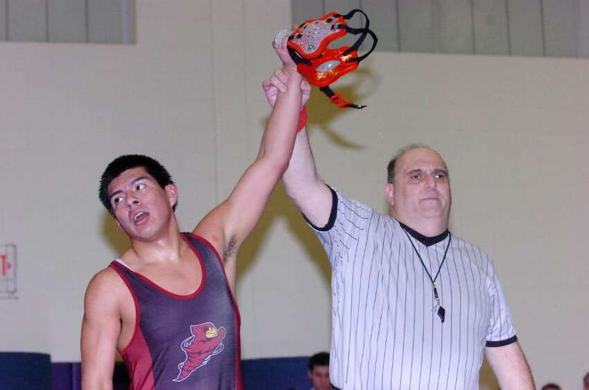 Greenwich's Miguel Gomez takes the win in the 171 pound division as Westhill High hosts Greenwich in a wrestling match Wednesday, January 20, 2010.