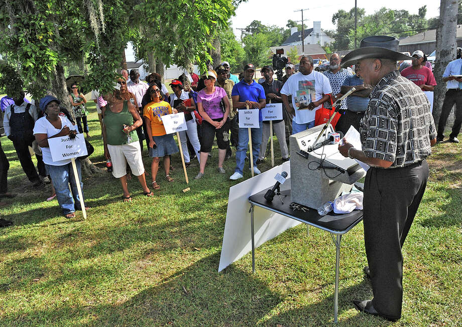 Paul Jones address a crowd during an NAACP rally at the Beaumont Independent School District on Thursday. Several supporters and a small group of opponents attended the event focused on the alleged mistreatment of a BISD employee.