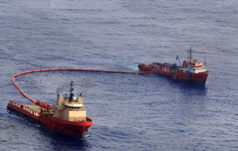 Ships try to control an oil spill in an offshore field operated by Chevron at the Bacia de Campos, in Rio de Janeiro state, Brazil on Nov. 13, 2011. Seventeen oil company executives faced criminal charges in March 2012, for the oil leak in the Atlantic, a legal action that prompted debate about whether it could slow Brazil's effort to develop its massive offshore finds. At least 110,000 gallons (416,000 liters) of oil seeped through cracks on the ocean floor near a Chevron Corp. appraisal well off the Rio de Janeiro coast in November 2011. Photo: Associated Press