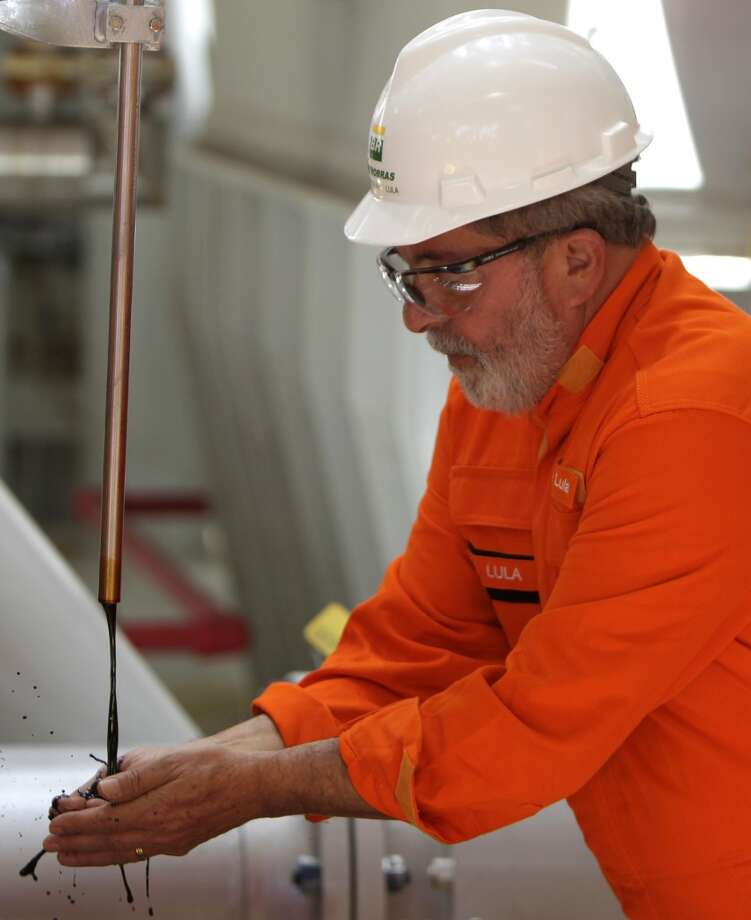 Brazil's then-President Luiz Inacio Lula da Silva covers his hands with the first production oil sample from the pre-salt layer of Tupi field as he visits a Petrobras offshore ship platform in Santos Bay, off the coast of Rio de Janeiro, Brazil on Oct. 28, 2010. Silva left the helm of a nation transformed from a perennial underachiever into one with economic and political clout. Photo: Felipe Dana, AP
