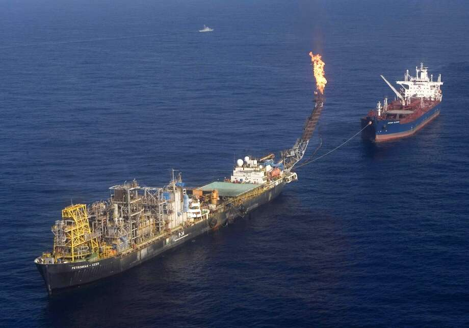 A P-34 Petrobras' platform, left, is seen 75 miles east of Vitoria, Brazil on Sept. 2, 2008. Photo: Eraldo Peres, AP